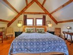 The master bedroom offers comfortable king-sized bed.