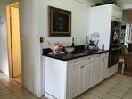 Wetbar with double oven with view down hall to 2nd bath and 2nd bedroom