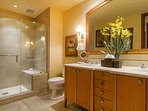 Second bathroom with dual vanities and walk in shower.