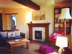 The Mill Living Room - with plenty of beams, this is the quintessential English cottage.