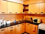 Modern kitchenette with all modern appliances including dishwasher