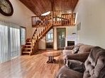 Snuggle up to the gas fireplace in this cozy loft.
