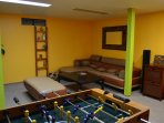 Game room with foosball table, TV and game consoles