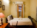 Tastefully furnished bedroom with unattached but exclusive bathroom