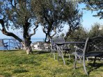 The garden with its beautiful view of the Gulf of Naples, with benches, small table, and hammock