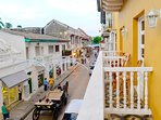 View of Calle Segunda de Badillo from the balcony, often with a horse drawn carriage passing by!