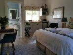 Studio interior showing open plan kitchenette and en-suite bathroom