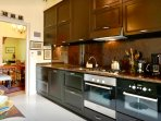Kitchen with modern appliances-dishwasher, oven, microwave, coffee makers, toaster, fridge and more