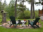 Brand new natural stone fire pit, stump serving table and four adirondacks. Extra chairs close by!