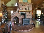 Gas fireplace in living room w vaulted ceiling, fan and comfy glam decor!