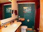 Downstairs bath w shower/tub combo.