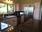 Kitchen features granite counters and stainless applicances