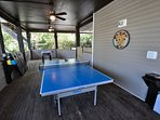 Games area with deluxe ping pong table, foosball table + corn hole (sandbag) game