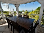 Teak dining table with great Gulf views !