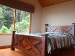 The Bedroom with Custom Head and Foot board Made from Lumber Harvested on our Ranch