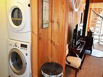 Laundry area in hall with stackable washer/dryer