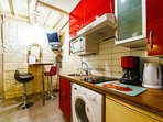 New Fitted Kitchen is furnished with hotplates, fridge, washer, sink, cupboards,  tableware, etc.