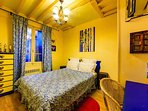 Romantic Bedroom is equipped with queen size bed, spacious closet, chest of drawers, night tables.