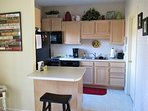 Fully Equipped, Clean Kitchen and Laundry Room with Washer & Dryer