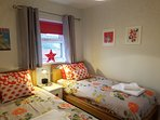 Bedroom 2 with TV,  wardrobes and bookcase with plenty to read for adults and children!