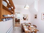 The dining room is beautifully equipped for an great foodie's holiday by the sea