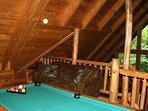 Queen sleeper sofa and pool table in loft.