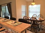 Kitchen dining area table and chairs, leather bar stools, views of lake and pool area