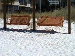 Beach swings at each beach entrance.