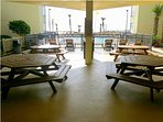 Picnic tables between the towers, near the center pool