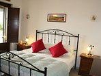Bedroom 1 with doors to terrace and en-suite shower room