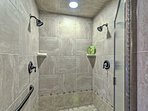 This large shower has double shower heads.