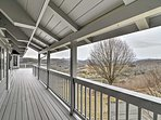 The covered deck is a beautiful place to watch the rain fall.
