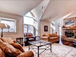The living area has pitched ceilings in this top floor unit.