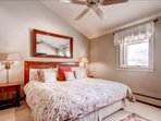 The master suite has a comfortable king bed.