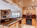 The kitchen is open to the living area and fully equipped