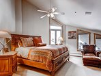 The master bedroom has a grand carved sleigh bed.