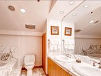 His and hers sinks make this bathroom comfortable as you get ready.