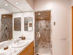 The glassed in shower is a nice touch to the master bath.