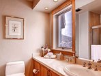 The second bathroom has natural light.