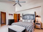 The master suite has a comfortable king size bed.