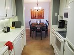 Full kitchen with adjacent dining area.