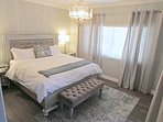 Master bedroom with king size bed and en suite bathroom