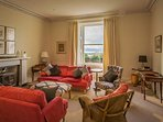The sitting room has wonderful views out to the Loch