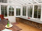 South facing conservatory with french doors leading to garden