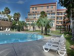 Lots of lounge chairs around the \'Resort Pool\' - as well as BBQ grills