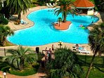 Our resort type pool has a swim around island