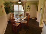 Folks like to gather around the dining room table to dine or play games.