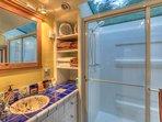 Isle Dream:  Custom tiled bathroom with Shower for Two built into Skylight.  Shower under the stars.