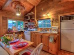 Isle Dream: Small efficient Kitchen with charm and everything two people need to prepare a meal.