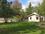 Two cabins, large beach, fitness center and fish cleaning on beautiful private and pristine lake.